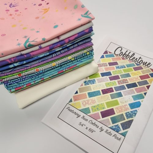 cobblestones quilt kit featuring tula pink fabric