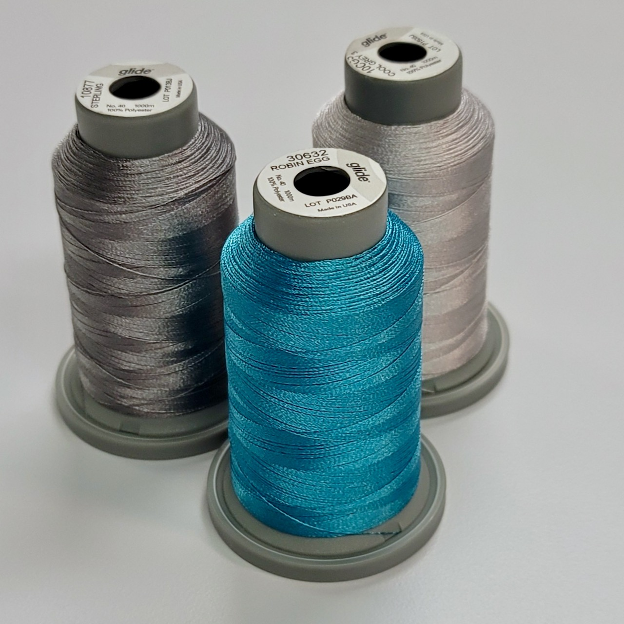 teal and gray thread collection